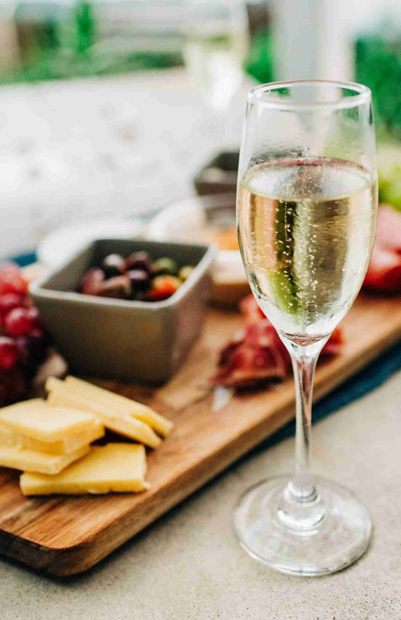 glass of sparkling wine with food